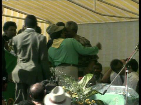 Mandelas marriage rift EXT MS Winnie and Nelson Mandela toward holding hands through gardens LMS Nelson Mandela embracing Winnie at ANC rally LS...