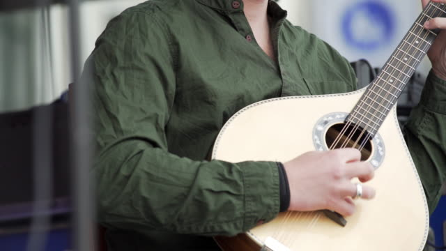 Mandolin Player Performing On Stage (4K/UHD)