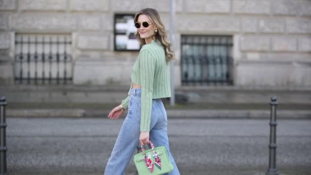 mandy bork is seen wearing green asymmetric cardigan storets, ripped zara denim jeans, green heels bottega veneta, hermes bag in green, sunglasses... - jeans stock videos & royalty-free footage