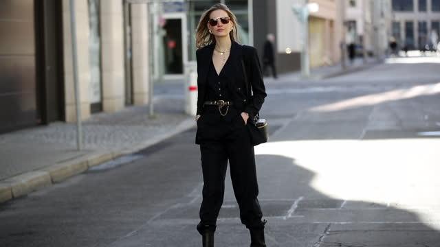 mandy bork walks while wearing black dior bag, bottega veneta sunglasses, bottega veneta boots, etro suit and belt and a dior watch on march 08, 2021... - footwear stock videos & royalty-free footage