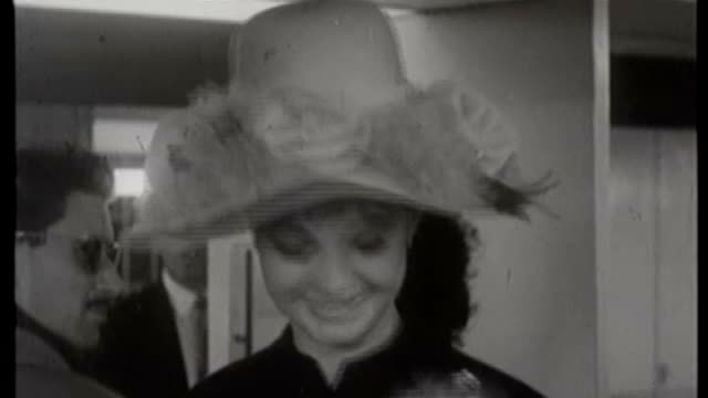lap b/w mandy ricedavis poses wearing large hat with rose decoration and holding toy dog - mandy rice davies stock videos & royalty-free footage