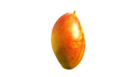 mango spinning and rotating isolated on white background food suspended in the air - mango fruit stock videos & royalty-free footage
