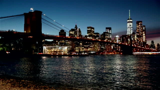 manhattan and brooklyn bridge at sunset, new york city - brooklyn bridge new york city stock videos and b-roll footage