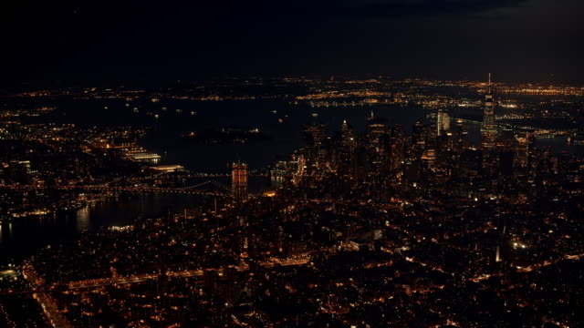 aerial manhattan and brooklyn bridge in the background at night - brooklyn bridge stock videos & royalty-free footage