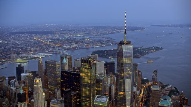 aerial manhattan and governors island in the background at dusk - world trade center manhattan video stock e b–roll