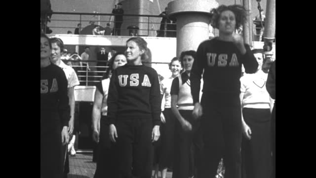 SS Manhattan at sea the ship that bears US Olympic athletes to the 1936 Summer Games in Berlin / flags with Olympics logo flutter in breeze on ship /...
