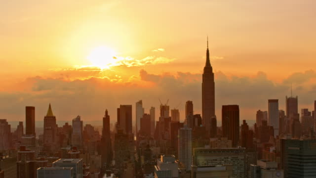 aerial manhattan at sunset - urban skyline stock videos & royalty-free footage