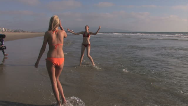 Manhattan Beach, California, USATwo young women are playing on the beach