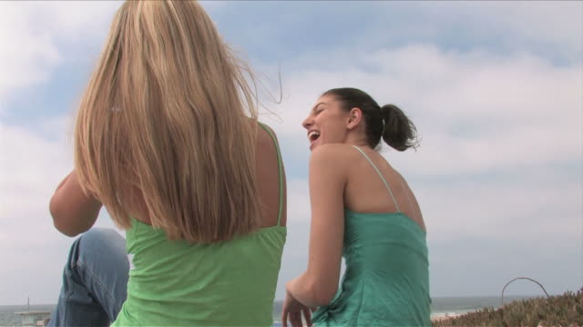Manhattan Beach, California, USATwo young women are talking on the beach