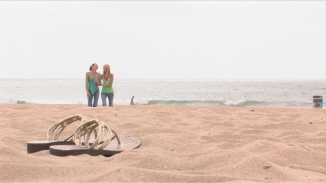 Manhattan Beach, California, USATwo young women are walking on the beach