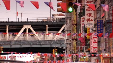 manhattan bridge chinatown in new york city - chinatown stock videos & royalty-free footage