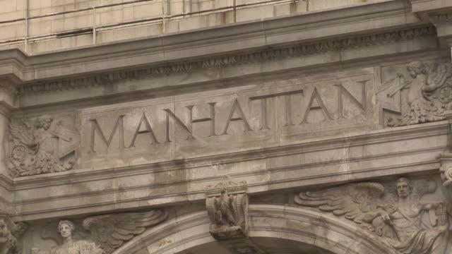 "ECU, ""Manhattan"" engraved on Washington Square Arch, Washington Square Park, New York City, New York, USA"