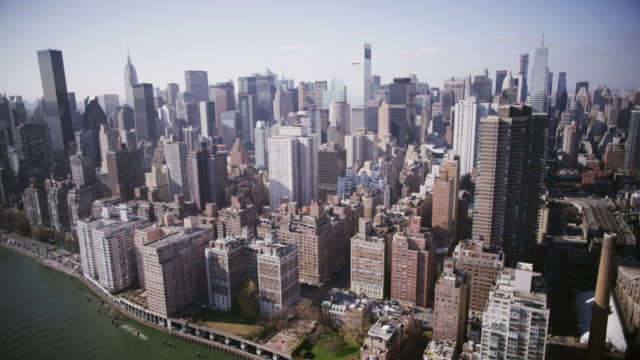hd aerial: manhattan from the east river - empire state building stock videos & royalty-free footage