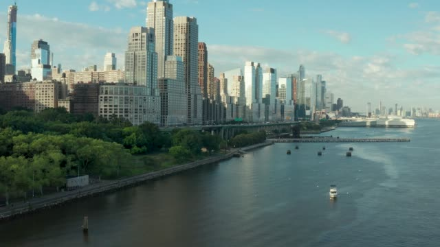 manhattan from the hudson river, drone view - waterfront stock videos & royalty-free footage