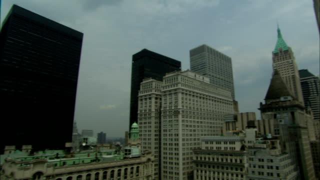manhattan high-rises reach into the sky. - manhattan video stock e b–roll