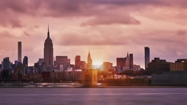 manhattan midtown skyline sunset - international landmark stock videos & royalty-free footage