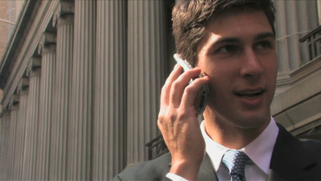 stockvideo's en b-roll-footage met manhattan, new york city, new york, usaone young business man is talking on the mobile phone at wall street - 2007
