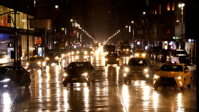 manhattan night traffic in rain - manhattan new york city stock videos & royalty-free footage