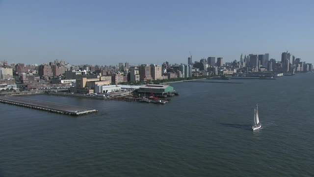AERIAL Manhattan skyline along the banks of the Hudson river / New York City, New York, United States