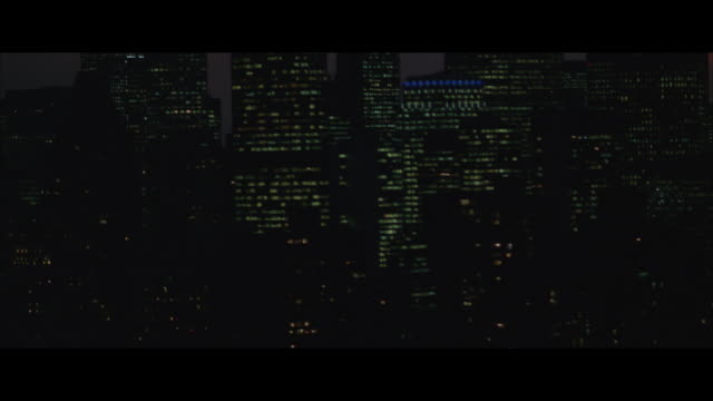 low aerial, manhattan skyline and queensboro bridge at night, new york city, new york, usa - レターボックス点の映像素材/bロール