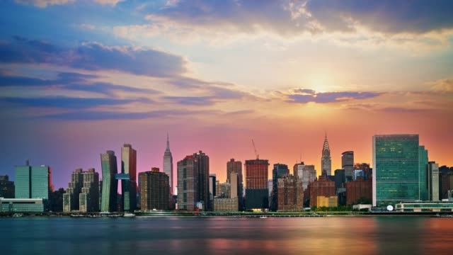 manhattan skyline at sunset - river east stock videos & royalty-free footage