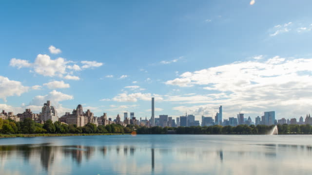 manhattan skyline from the reservoir - central park reservoir stock videos and b-roll footage
