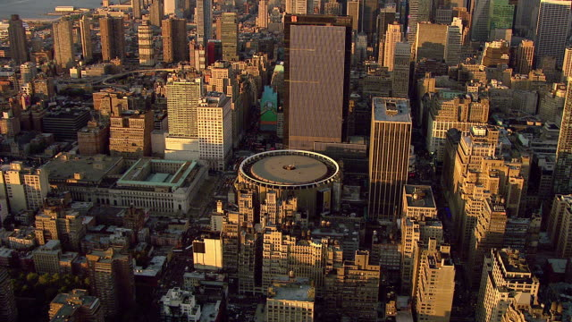 Manhattan skyline metropolis cityscape with Empire State Building in distance DESCENDING TD ZI OVER Madison Square Garden top NYC