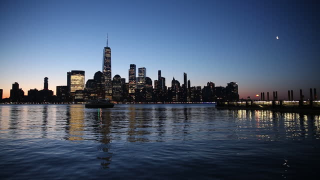 manhattan skyline seen across hudson river at sunrise, from the waterfronts of jersey city and hoboken, nj, new york city, ny, u.s. on tuesday, april... - rippled stock videos & royalty-free footage