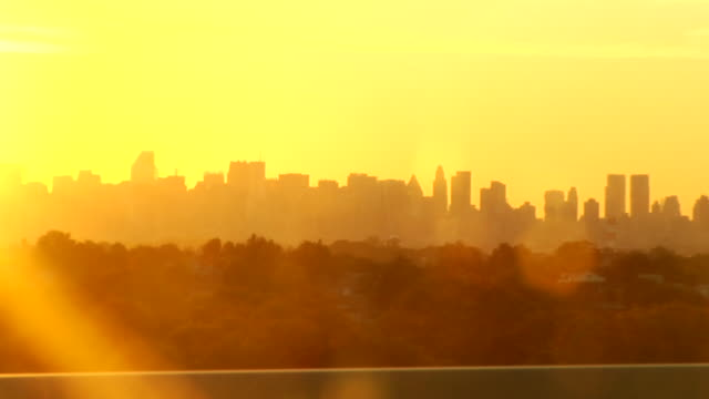 SIDE POV, Manhattan skyline seen from moving car at sunset, New York City, New York, USA