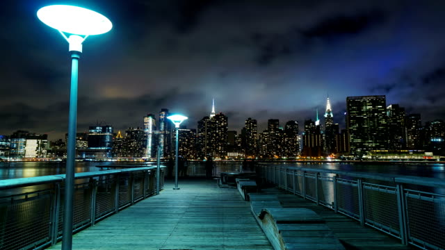 manhattan skyline time-lapse night - empire state building video stock e b–roll