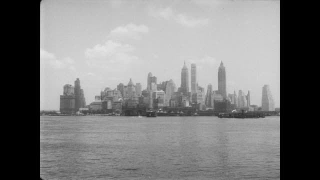 1954 ls of manhattan skyline viewed from governor's island - 1954 stock videos & royalty-free footage