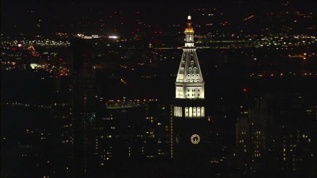 LOW AERIAL Manhattan skyline with 40 Wall Street originally Bank of Manhattan Trust illuminated at night / New York City, New York, USA
