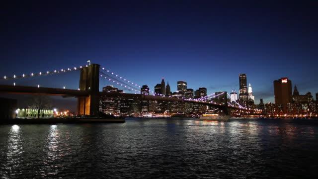 ws manhattan skyline with brooklyn bridge at night / new york city, usa - brooklyn bridge stock videos & royalty-free footage