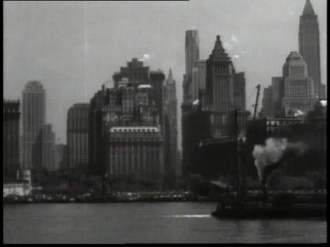 1932 ws manhattan skyline with ferry going by / new york city, new york, united states - 1932 stock videos & royalty-free footage