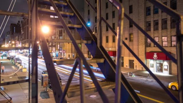 manhattan street seen through fire escape - timelapse - fire escape stock videos & royalty-free footage