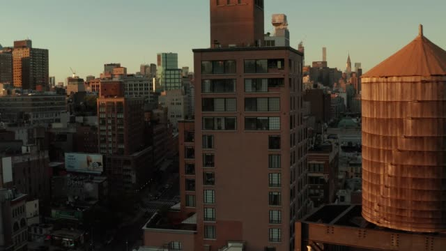 manhattan sunset from a drone - new york city stock videos & royalty-free footage