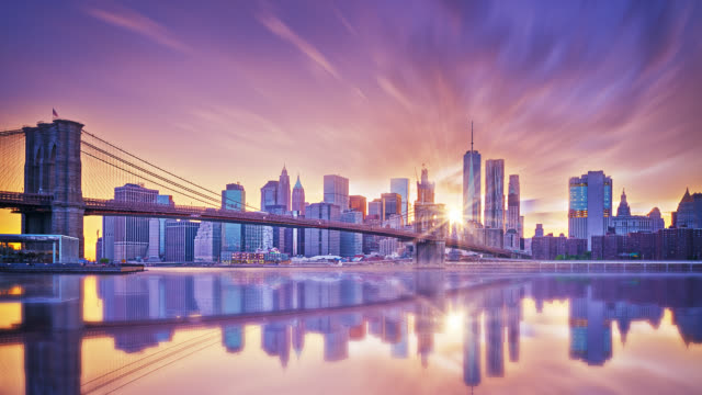 manhattan sunset from brooklyn bridge park - urban skyline stock videos & royalty-free footage