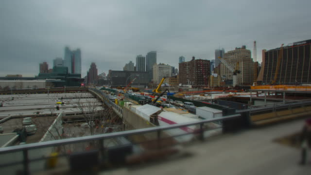 manhattan time lapse construction site fast moving people - figurine stock videos and b-roll footage
