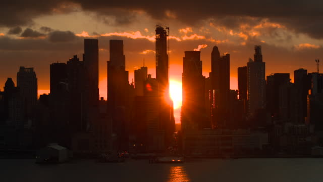 """Manhattanhenge"" the sun comes up between the buildings on 57th Street in New York City."