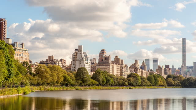 manhattan's upper east side from the reservoir - central park reservoir stock videos and b-roll footage