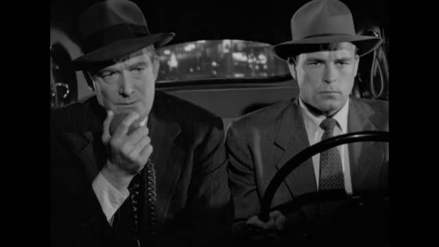 vídeos y material grabado en eventos de stock de 1948 a manhunt for a suspected killer intensifies - walkie talkie