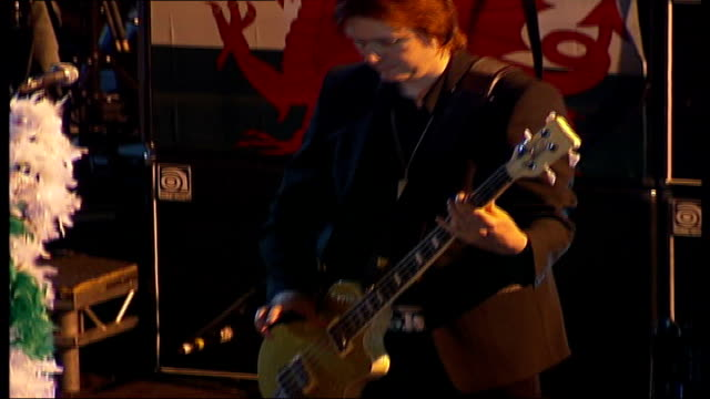 'manic street preachers' tour; **nicky wire interview partially overlaid sot** band, including wire standing next microphone stand decorated with... - manic street preachers stock videos & royalty-free footage
