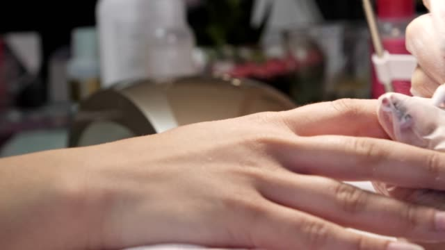 manicure. beauty and relax. young woman getting her nails done in salon by manicure worker - manicure stock videos & royalty-free footage