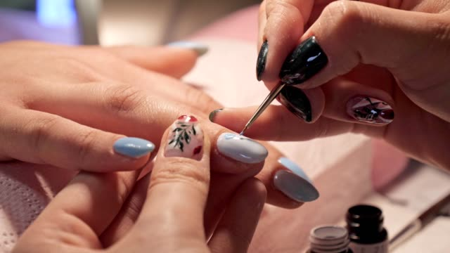 Manicure. Beauty and relax. Young woman getting her nails done in salon by manicure worker
