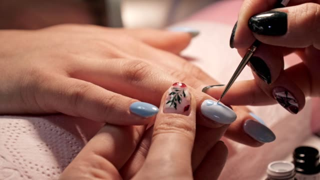 vídeos de stock e filmes b-roll de manicure. beauty and relax. young woman getting her nails done in salon by manicure worker - manicure