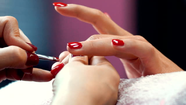 manicure procedure. - red nail polish stock videos and b-roll footage