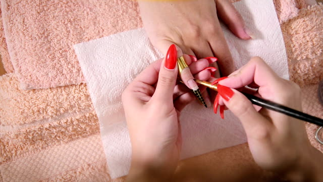 manicure treatment. - red nail polish stock videos and b-roll footage