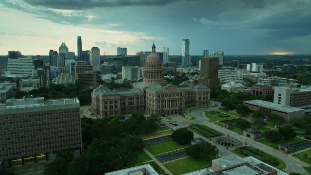 manicured grounds around the texas state capitol building - drone shot - texas state capitol building stock videos & royalty-free footage