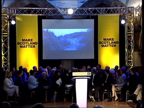 snp manifesto launched scotland glasgow cms scottish national party election broadcast narrated by sir sean connery being shown at launch of snp... - scottish national party stock videos & royalty-free footage