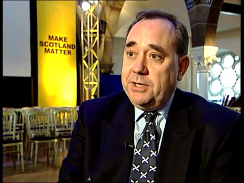 snp manifesto launched ms snp supporters standing and applauding pan salmond holding up manifesto ext i/c int cms alex salmond interview sot opinion... - alex salmond stock videos & royalty-free footage
